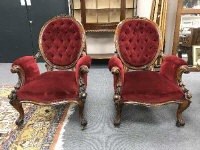 A pair of fine quality Victorian walnut armchairs, upholstered in red velvet, width 72 cm. (2)