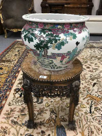 A Chinese hardwood plant pedestal inset with rouge marble, height 45 cm, diameter 40 cm, together with a Chinese planter. (2)