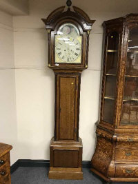 An early 19th century inlaid oak long cased clock with painted moon phase dial, height 238 cm.
