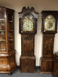 A 19th century mahogany long cased clock with classical painted dial by Roberts, height 221 cm.