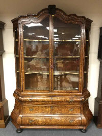 An 18th century Dutch marquetry display cabinet on bombe three drawer chest base, standing on bun feet, height 235 cm.
