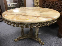 A good quality variegated onyx coffee table, on brass tri form base, with onyx pillars, width 75 cm.