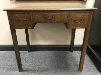 A George III oak side table fitted with three drawers on square legs, width 84 cm.