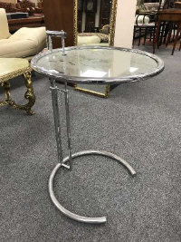 A mid 20th century tubular steel adjustable glass topped circular coffee table, diameter 51 cm.