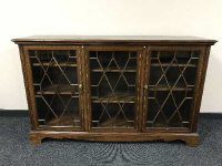 A Victorian inlaid mahogany triple door glazed bookcase, width 154 cm.
