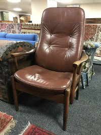 A mid twentieth century brown leather armchair, height 110 cm.
