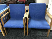A pair of mid twentieth century oak framed armchairs upholstered in blue fabric, width 63 cm. (2)