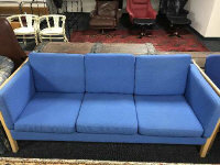 A continental contemporary beech framed three seater settee upholstered in blue fabric, width 187 cm.