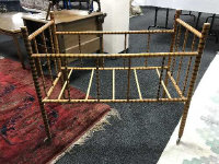 A mid twentieth century bamboo framed child's cot, length 94 cm.