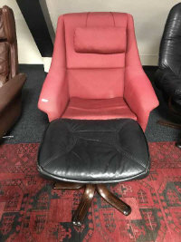 A mid twentieth century Scandinavian adjustable swivel chair upholstered in red fabric, together with a black leather footstool (2)