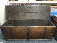 An 18th century oak iron bound shipping chest, width 156 cm.