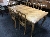 A French oak country dining table 90.5 cm x 160.5 cm, together with six matching chairs. (7)
