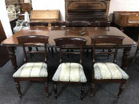 An early Victorian mahogany extending dining room table, width 117.5 cm, with three leaves, winding handle, on reeded legs, together with a set of six 19th century dining chairs upholstered in three-tone fabric.  (7)