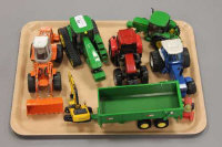A collection of die-cast farm vehicles including John Deere tractor etc. (Q)