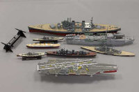A collection of military model war ships and aircraft carriers. (Q)