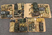 A large collection of military model tanks and vehicles. (Q)