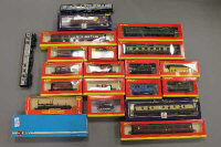 A collection of Hornby and other rolling stock, carriages etc. (Q)