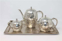 A four piece silver tea service, comprising of twin-handled serving tray, teapot, coffee pot and twin-handled sugar pot, the tray 45cm wide, foreign marks, stamped 800, 3,313g gross. (4)