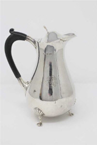 A silver hot water jug, Henry Wigfull, Sheffield 1910, of baluster form, height 18cm, 333g