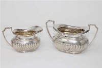 A silver sugar bowl and matching cream jug, Henry Wigfull, Sheffield 1908, the sugar bowl 8cm high, 324g gross. (2)
