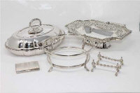 A collection of silver plated wares to include a lidded entree dish, a swing-handled basket, pair of knife rests, card case etc