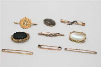 A collection of 9 Victorian and later brooches in yellow metal, some indistinctly stamped. (9)