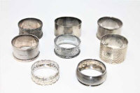Eight silver napkin rings, 160.4g. (8)