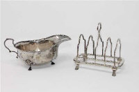 A silver toast rack, Sheffield 1926, together with a silver sauce boat, 255.6g. (2)