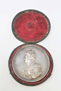 An early 18th century silver commemorative medal - Anne, The Union with Scotland, 70mm diameter, 100.4g, in original shagreen covered case.