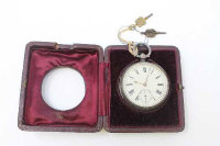 A silver open faced pocket watch, Chester 1881, with two keys and travel case.