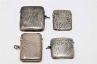 A silver vesta case, Birmingham 1919, together with three further silver vesta cases, 118.9g. (4)