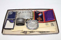 A silver napkin ring, together with an antique Chinese ivory letter opener, silver pin dish, continental silver and enamel dish, badges, etc