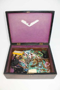A Victorian mahogany box containing costume jewellery, French pins, coins, necklaces, etc