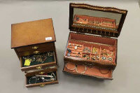 Two jewellery chests containing a collection of costume jewellery; rings, necklaces, earrings etc. (Qty)