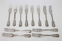 A Harlequin set of twelve George III and later King's pattern silver dessert forks, various makers and dates, each engraved with a crest, 772g gross. (12)