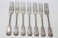 A set of seven George IV Fiddle and Shell pattern silver table forks, George Samuel Lewis, Newcastle 1825, engraved with a crest, 589g gross. (7)