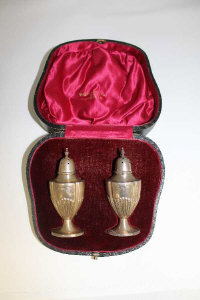 A cased pair of silver sifters by Walker and Hall , Sheffield.