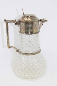 A Victorian cut glass and silver mounted claret jug.