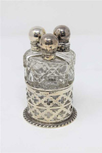 A silver three-part dressing table bottle set, Birmingham, John Grinsell & Sons.
