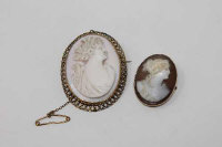 Two Victorian 9ct gold mounted cameo brooches depicting classical ladies. (2)