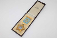 A 9ct gold and enamel Masonic medal, inscribed 'Presented to W. Bro. Brierley Taylor by the Doric Lodge No.3384...', dated 1935, the ribbon with two gold suspension bars, 35g gross.