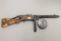 A Deactivated Finnish Suomi KP-31 9mm Submachinegun, serial number 64137, circa 1943, with a 36 round box magazine and a scarce 71 round drum magazine, also with two defunct 9mm bullets, accompanied by a Birmingham Gun Barrel Proof House certificate numbered 145250 and dated 21/03/2018.