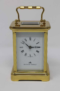 A modern brass cased Matthew Norman carriage clock, with enamel dial and platform escapement, height 14.5cm above handle.