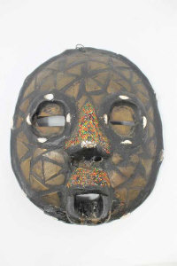 An African Baluba mask with metal inlay and beadwork decoration, height 27cm.