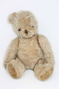 A vintage jointed mohair teddy bear with growler, height 50cm.