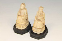 A pair of 19th century Chinese carved ivory figures of an Emperor and Empress, on wooden bases, height, 9.5cm.