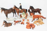 A group of Beswick and similar figures to include; Beswick Girl on Skewbald pony 1499 (a/f), Beswick Mare 1st version facing right head up, grey (a/f),  five Beswick foxes, Beswick Huntswoman 1730 style 2 standing, brown (a/f), Bois Roussel Racehorse 2nd version, brown, and two other non-Beswick figures. (Qty)