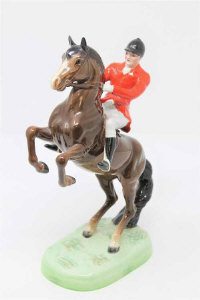 A Beswick Huntsman on rearing horse 868, style 1 second version, brown.