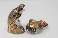 A Royal Crown Derby Bronze Winged Parrot paperweight, gold stopper, together with Robin with silver stopper. (2)
