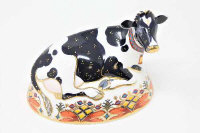 "A Royal Crown Derby Friesian Cow ""Buttercup"" paperweight with gold stopper."
